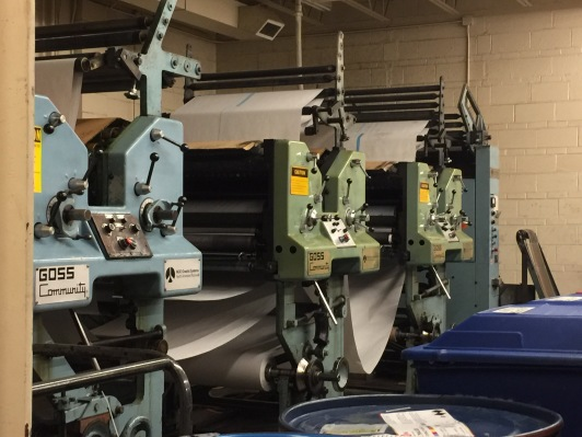 Newspapers are put through this printing machine. The university goes through literally barrels of ink every year to get the newspaper to everyone on campus